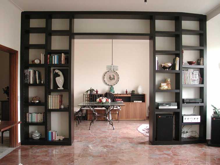 Librerie e scaffali in legno l 39 arte del legno - Libreria a parete ...